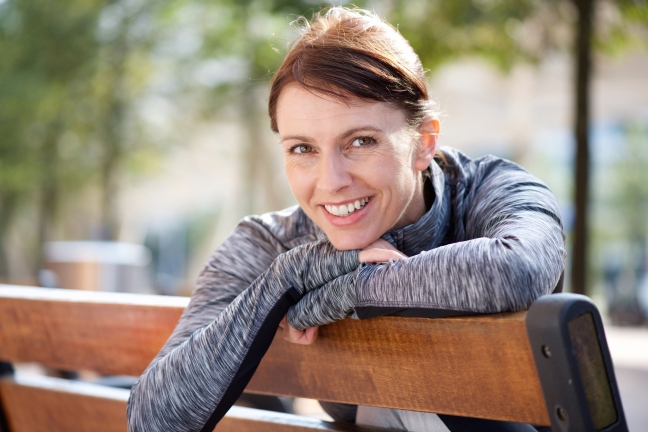 Smiling sports woman relaxing